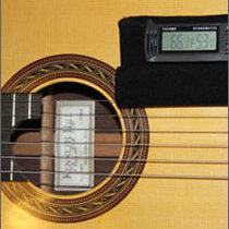 Guitar hygrometer holder